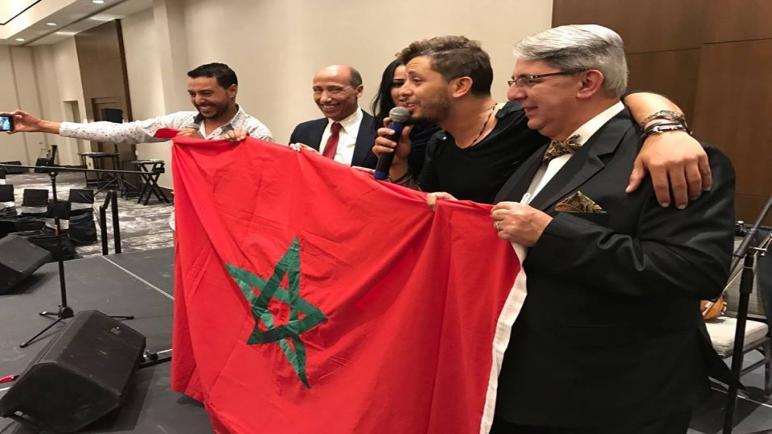 القنصل المغربي و البطل العالمي سعيد عويطة يحضران حفل حاتم عمور بأمريكا